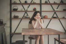 Sitting at table thinking